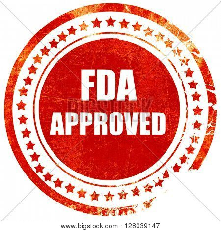 FDA approved background, grunge red rubber stamp on a solid white background
