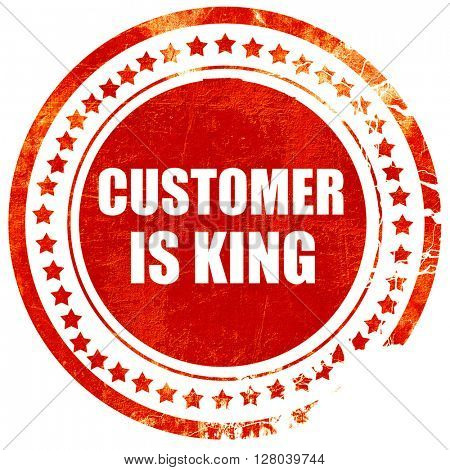 customer is king, grunge red rubber stamp on a solid white backg