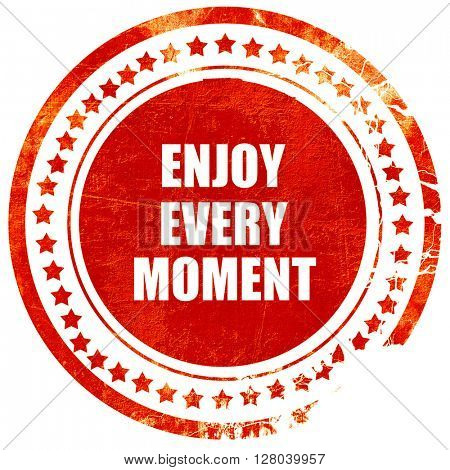enjoy every moment, grunge red rubber stamp on a solid white bac