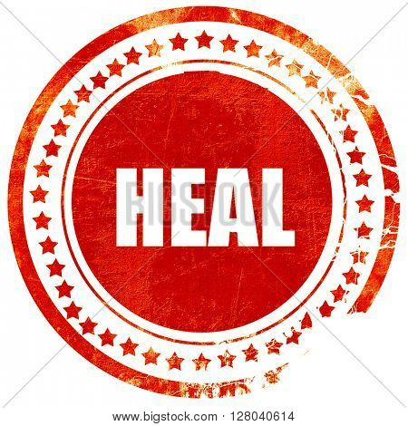 heal, grunge red rubber stamp on a solid white background