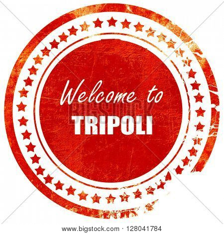 Welcome to tripoli, grunge red rubber stamp on a solid white bac