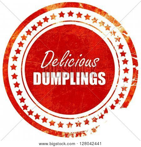 Delicious dumplings sign, grunge red rubber stamp on a solid whi