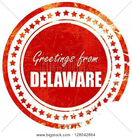 Greetings from delaware, grunge red rubber stamp on a solid whit