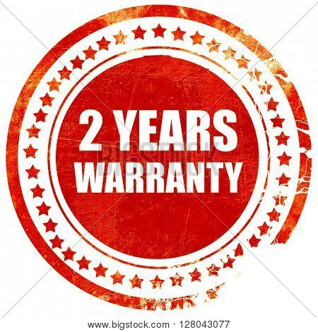 2 years warranty, grunge red rubber stamp on a solid white backg