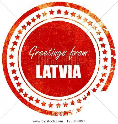 Greetings from latvia, grunge red rubber stamp on a solid white
