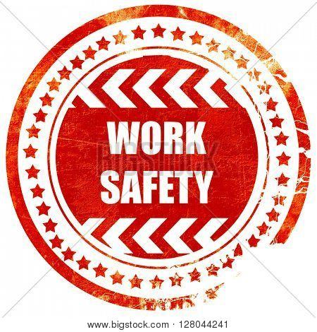 Work safety sign, grunge red rubber stamp on a solid white backg