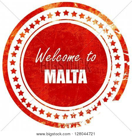 Welcome to malta, grunge red rubber stamp on a solid white backg