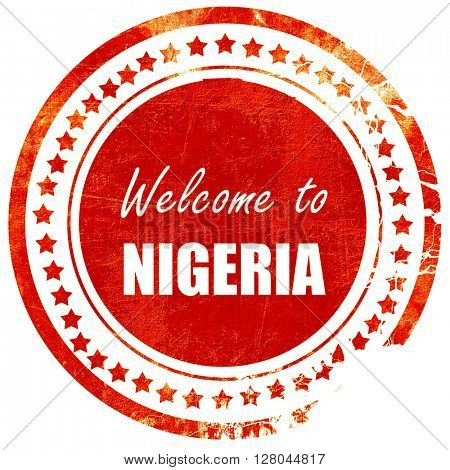 Welcome to nigeria, grunge red rubber stamp on a solid white bac