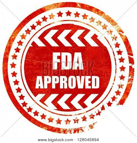 FDA approved background, grunge red rubber stamp on a solid whit