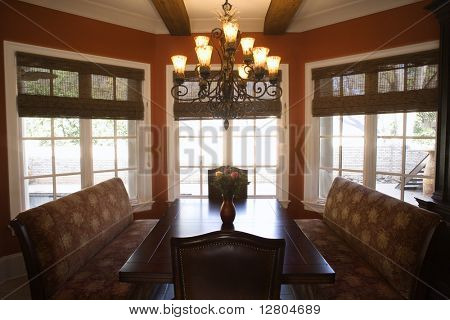 Dining room with table and chairs in affluent home.