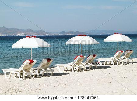 Kos Island. Three umbrella on the beach. Greece