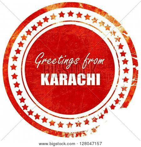 Greetings from karachi, grunge red rubber stamp on a solid white background