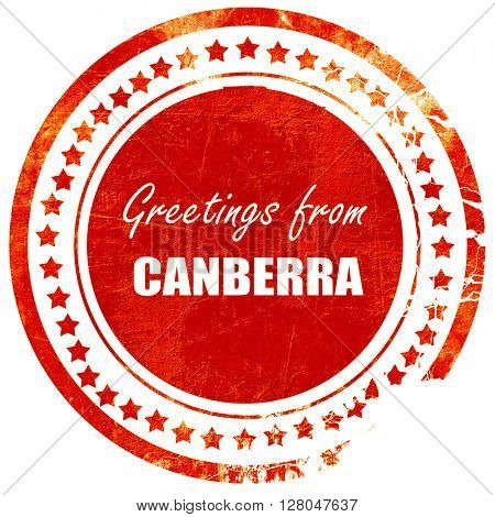 Greetings from canberra, grunge red rubber stamp  on a solid white background