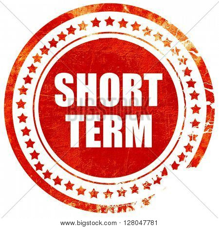 short term, grunge red rubber stamp on a solid white background