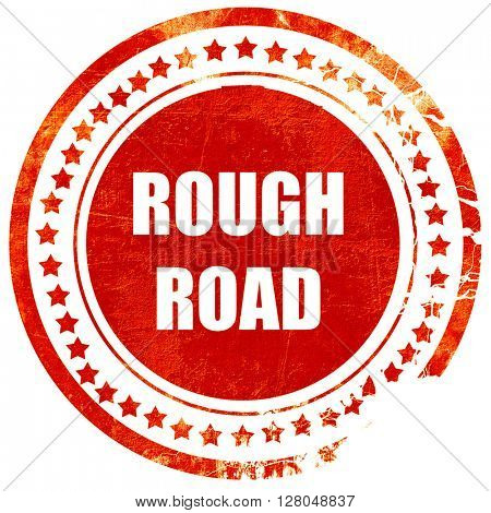 Rough road sign, grunge red rubber stamp on a solid white background