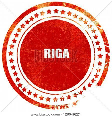 riga, grunge red rubber stamp on a solid white background