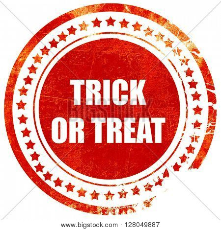 trick or treat, grunge red rubber stamp on a solid white backgro