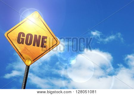 Yellow road sign with a blue sky and white clouds: gone sign bac
