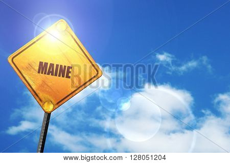 Yellow road sign with a blue sky and white clouds:  maine