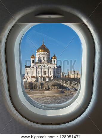 porthole and landmark Christ the Saviour Cathedral in Moscow against the backdrop of a frozen river