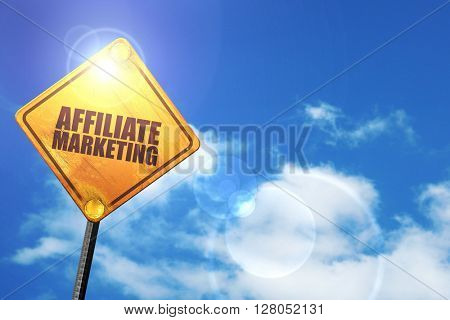 Yellow road sign with a blue sky and white clouds: affiliate marketing
