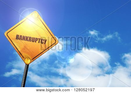 Yellow road sign with a blue sky and white clouds: bankruptcy