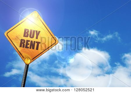 Yellow road sign with a blue sky and white clouds: buy rent
