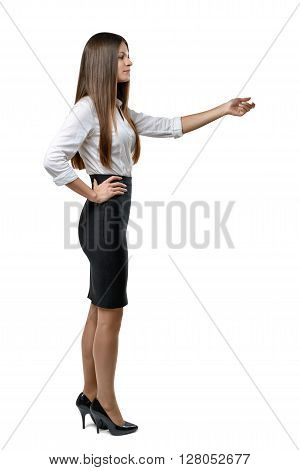 Cutout businesswoman in an office dress imitates the touch to something. Learning and cognition. Success and development. Business staff. Office clothes. Dress code. Presentable appearance. Beauty and youth. Profile pose.