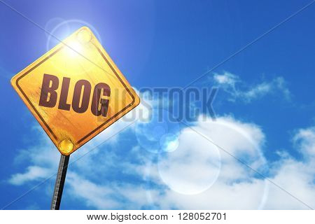 Yellow road sign with a blue sky and white clouds: blog