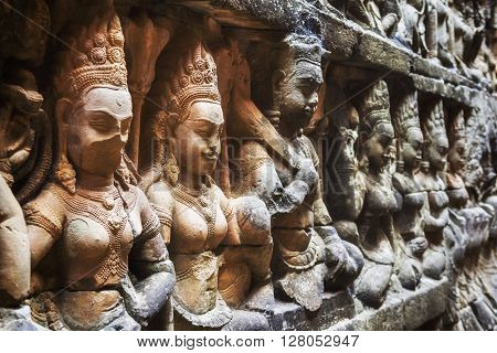 Terrace of the Leper King at Angkor Thom, Siem Reap, Cambodia. Close up detail of ancient bas relief carvings on the wall.