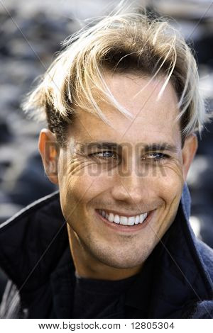 Portrait of blond Caucasian mid-adult male smiling.
