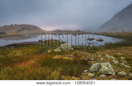 Small Tarn in West Tatra Mountains with Rocks in Foreground
