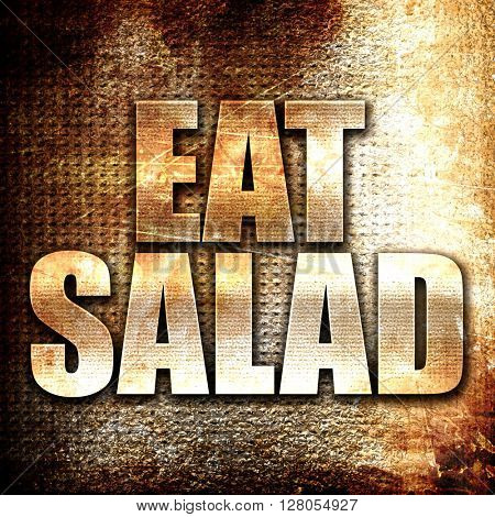 eat salad, written on vintage metal texture