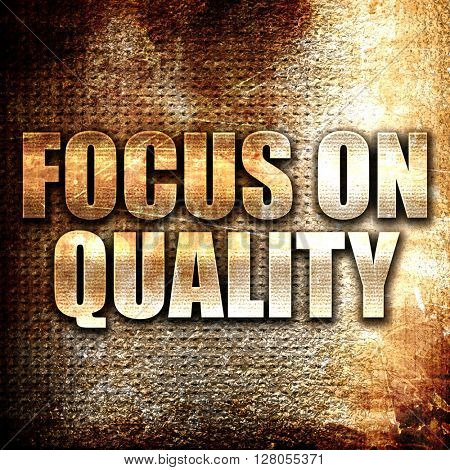 focus on quality, written on vintage metal texture