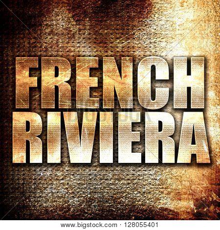 french riviera, written on vintage metal texture