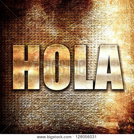 hola, written on vintage metal texture