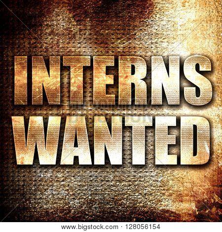 interns wanted, written on vintage metal texture