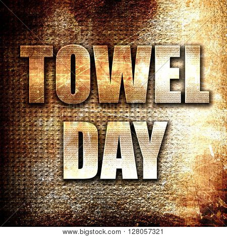 towel day, written on vintage metal texture