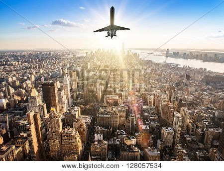 airplane over the skyline of new york