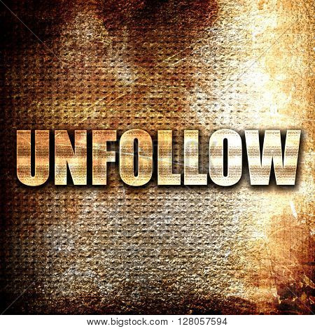 unfollow, written on vintage metal texture