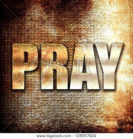 pray, written on vintage metal texture