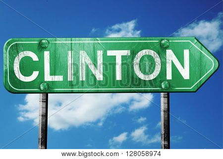 clinton road sign , worn and damaged look