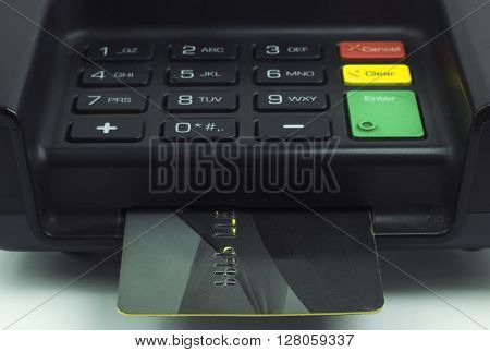 Credit Card inserted into a pin pad terminal - EMV Chip