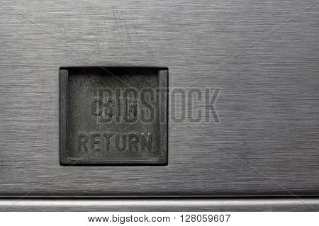 Coin Return Slot on a Pinball Machine ** Note: Visible grain at 100%, best at smaller sizes