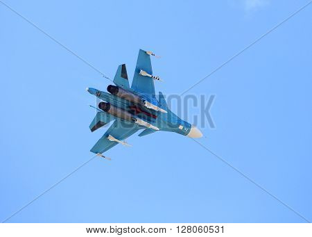 MOSCOW REGION - AUGUST 30: Russian fighter with rockets flying in a blue sky  on August 30, 2015 in Moscow region