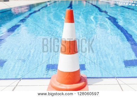 Swimming Pool Repair - Safety Cone On Edge