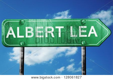 albert lea road sign , worn and damaged look