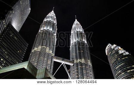 Kuala Lumpur, Malaysia - 28 January, 2016: Petronas towers by night. Petronas complex, Kuala Lumpur Convention Center.