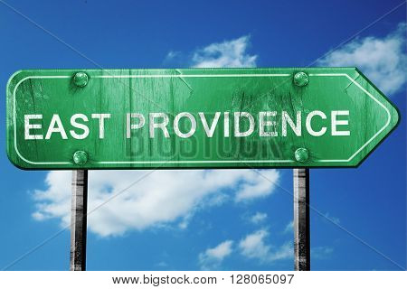 east providence road sign , worn and damaged look