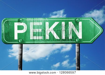 pekin road sign , worn and damaged look
